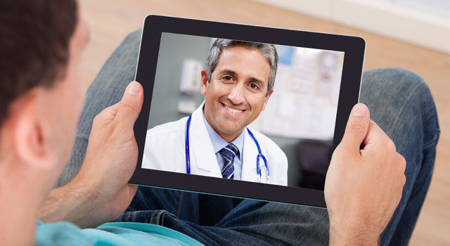 Man Having Video Chat With Female Doctor